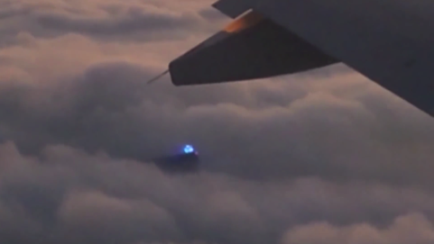 Glowing Blue Dome UFO Captured From Passenger Plane